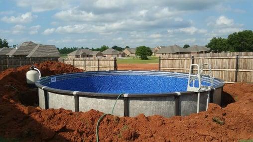 Above ground pool partial bury