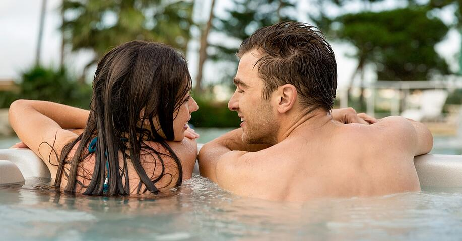 young couple hot tub.jpg